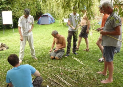 Men working together to build the tent